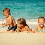 Kids enjoying the beach near Pantai Inn in La Jolla, California